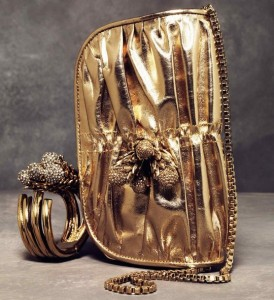 Roberto Cavalli gold bag and bracelet