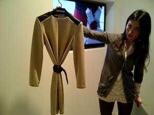 Tunic with brown leather shoulder detail and belt